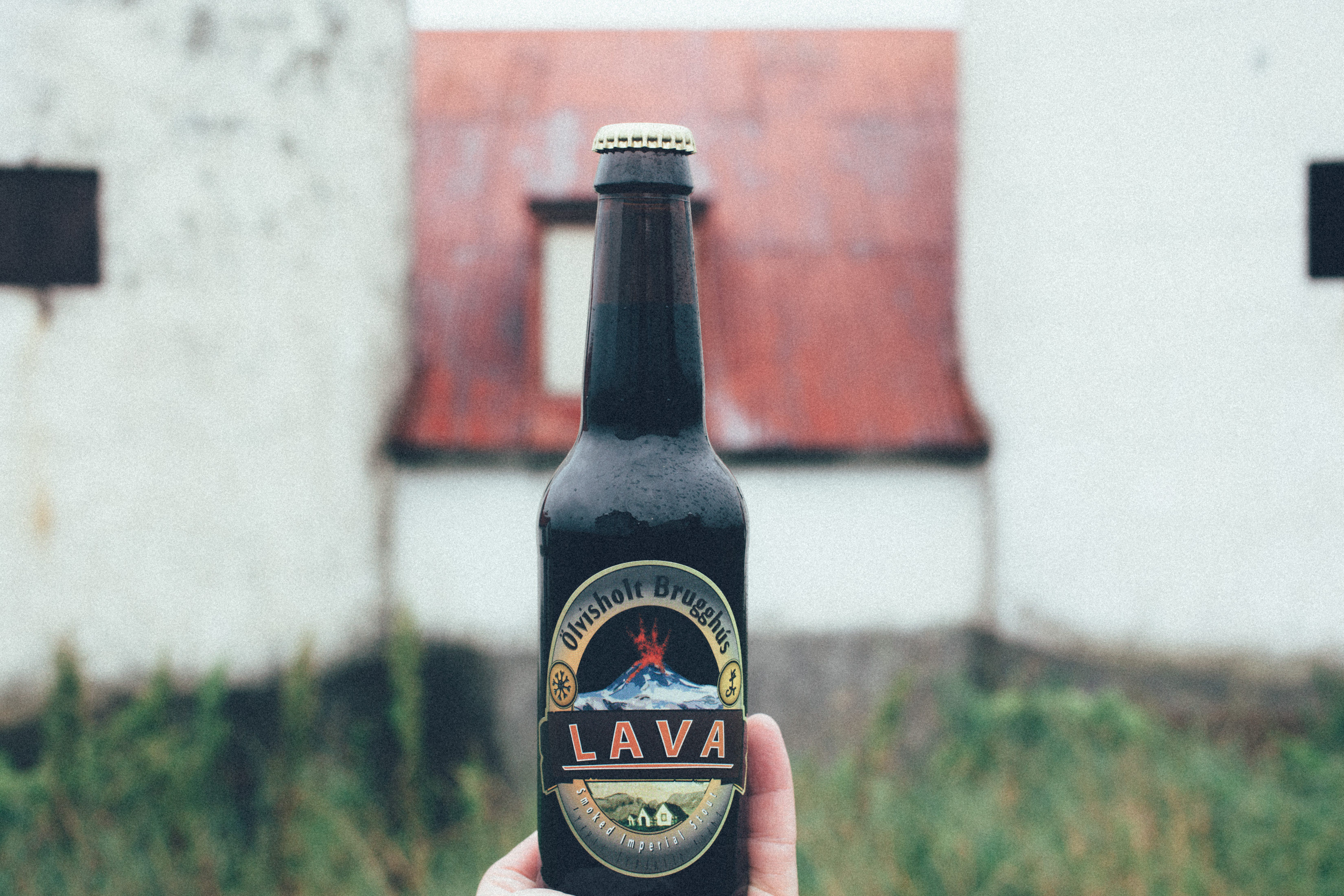 Olvisholt Lava Imperial Smoked Porter farmhouse in the background