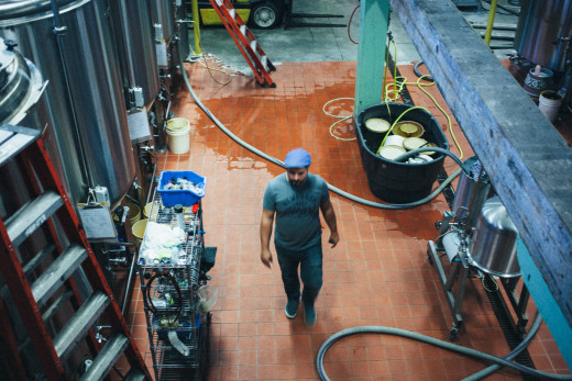 Newburgh Brewing Company Chris Basso walking the brewhouse