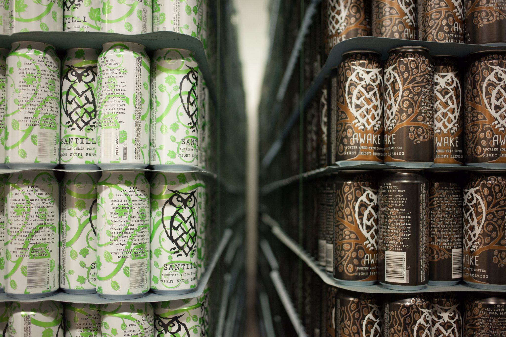 Empty beer cans of Santilli and Awake at Night Shift Brewing